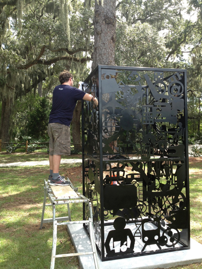 Roane State associate professor of art Bryan Wilkerson installs his piece