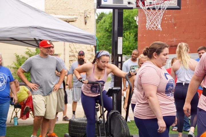 Lena Miller, a sophomore at Roane State, is pictured working out at the Dayton CrossFit facility while surrounded by other physical fitness fans.