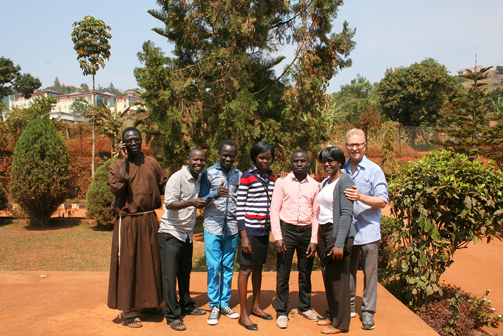 Richard Nesbit, at right, brother of Roane State Athletics Director Randy Nesbit, is shown with some of the residents of the African country of Uganda.