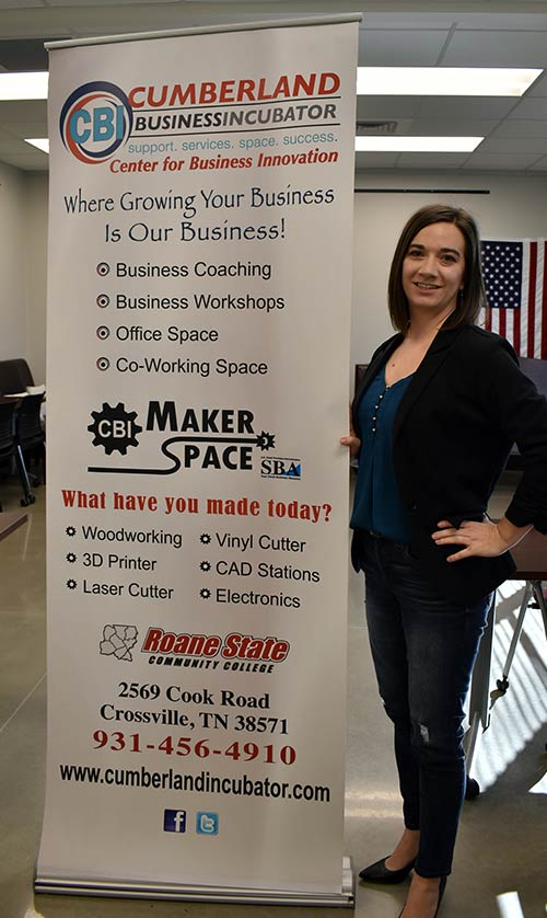 Shannon Johns, founder and owner of Thrive Therapy, is shown with a poster about the Cumberland Business Incubator, where her office is located.