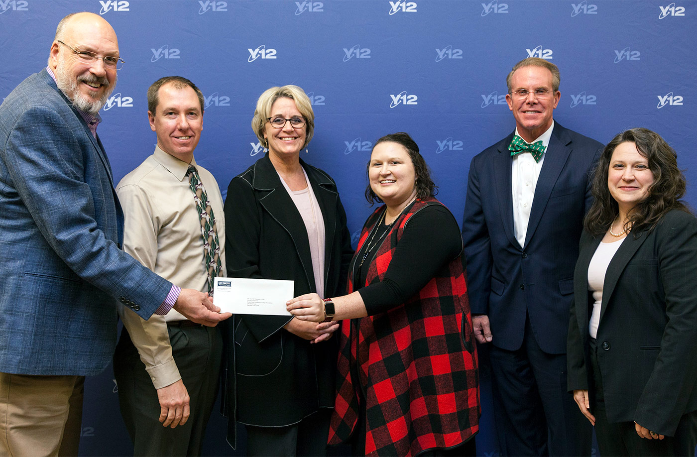 Making the grant presentation, from left: Robert Keen, chair of the Y-12 Employment Investment Advisory Committee; Scott Niermann, executive director of the Roane State Foundation; Teresa Duncan, Roane State vice president of workforce development and director of the college's Oak Ridge Branch Campus; Meghan Lovelace, committee secretary; Mike McClamroch, East Tennessee Foundation president and CEO; and Amy Wilson, CNS senior director of transformation.