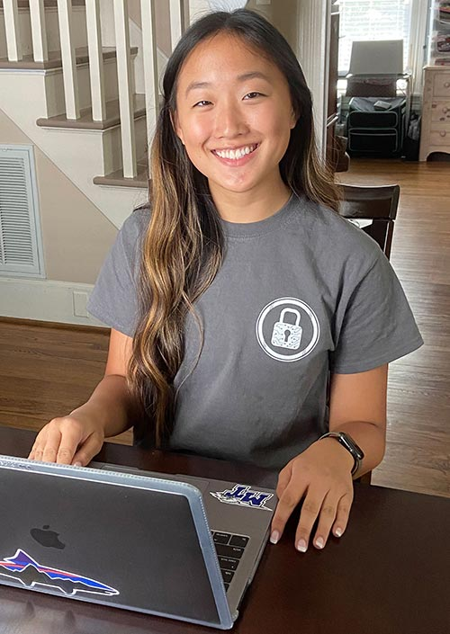 Student at their home attending Cybersecurity Camp