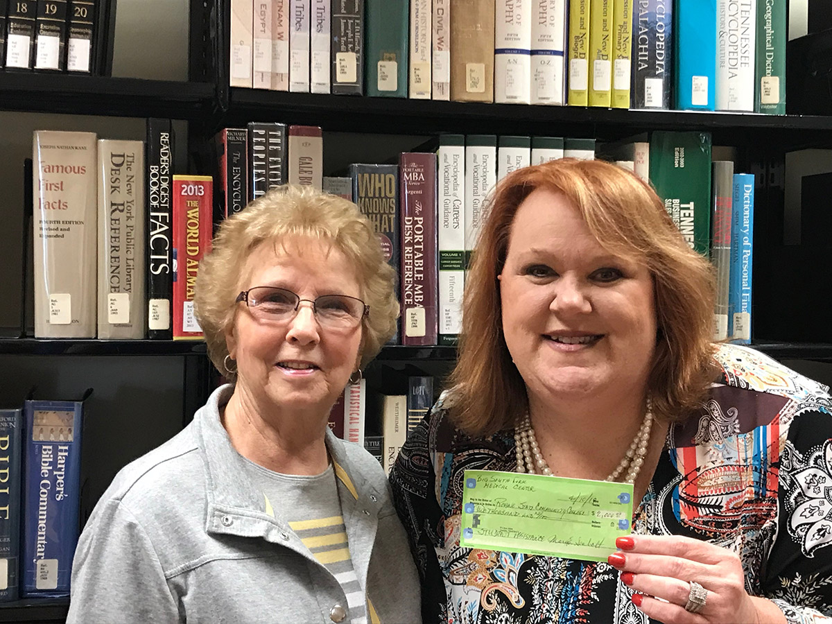 Sharon Wilson, right, director of Roane State's Scott County campus, holds a check representing a $2,000 donation to students at the campus given by volunteers at the Big South Fork Medical Center. Kay Botts, president of the volunteer organization, is at left.