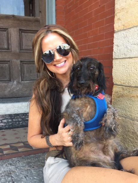 Melanie Stanley and her wire haired dachshund, Stewart Douglas Stanley. The dog has become something of a social media celebrity.